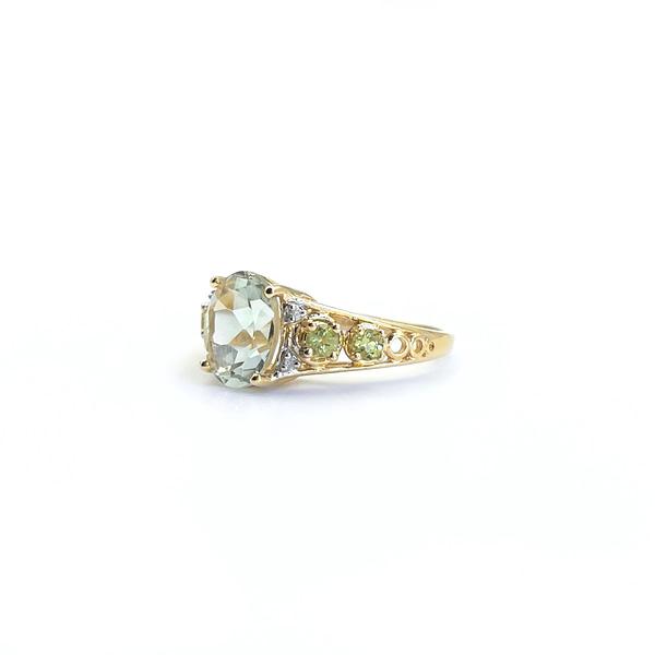 Gouden ring met groenblauwe edelsteen, peridoot en diamant