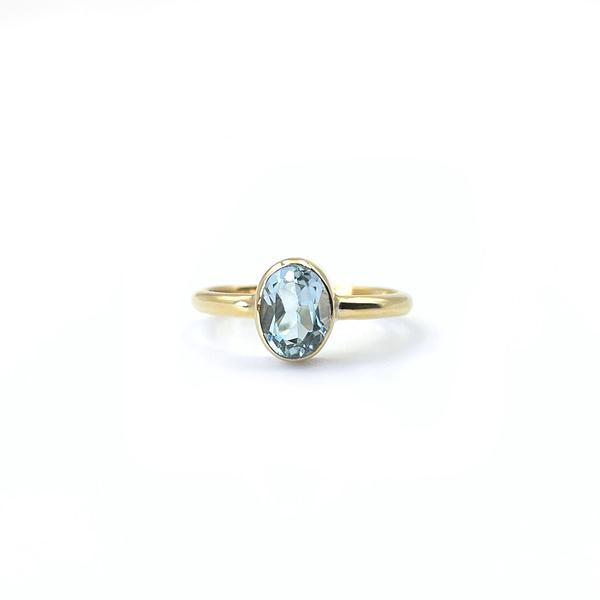 gouden ring met blauwe topaas ovaal geslepen vintage goud