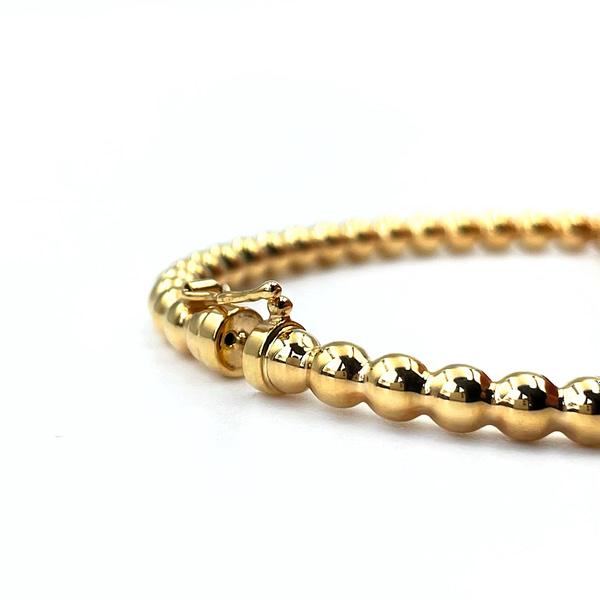 bangle van goud met bolletjes bubble bangle armband