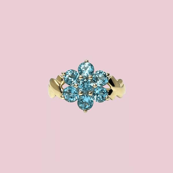 vintage ring met bloem van blauwe topaas